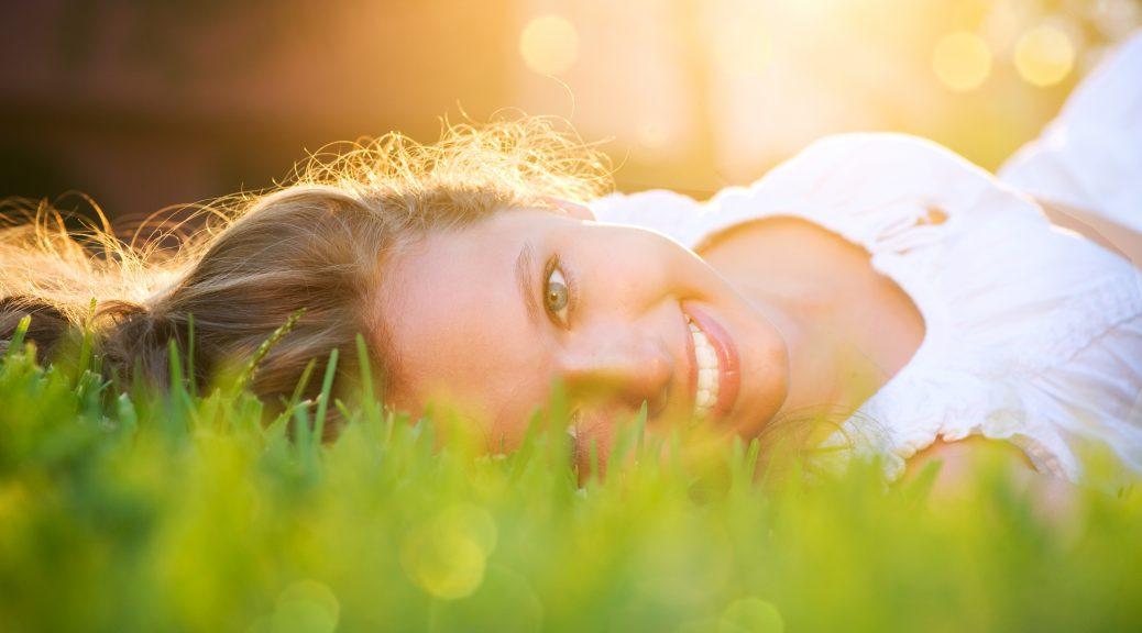 14022321 - spring girl in green grass